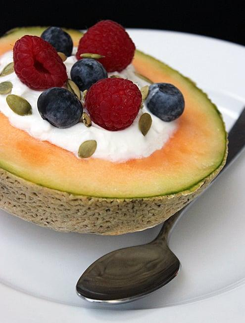 """<p>This cantaloupe breakfast bowl is the definition of refreshing. The creamy yogurt gives a protein boost, and it's as easy as cutting a melon in half.</p> <p><strong>Protein:</strong> 18.7 grams</p> <p><strong>Get the recipe:</strong> <a href=""""https://www.popsugar.com/fitness/Healthy-Breakfast-Idea-Yogurt-Filled-Cantaloupe-8384494"""" class=""""link rapid-noclick-resp"""" rel=""""nofollow noopener"""" target=""""_blank"""" data-ylk=""""slk:cantaloupe bowl"""">cantaloupe bowl</a></p>"""