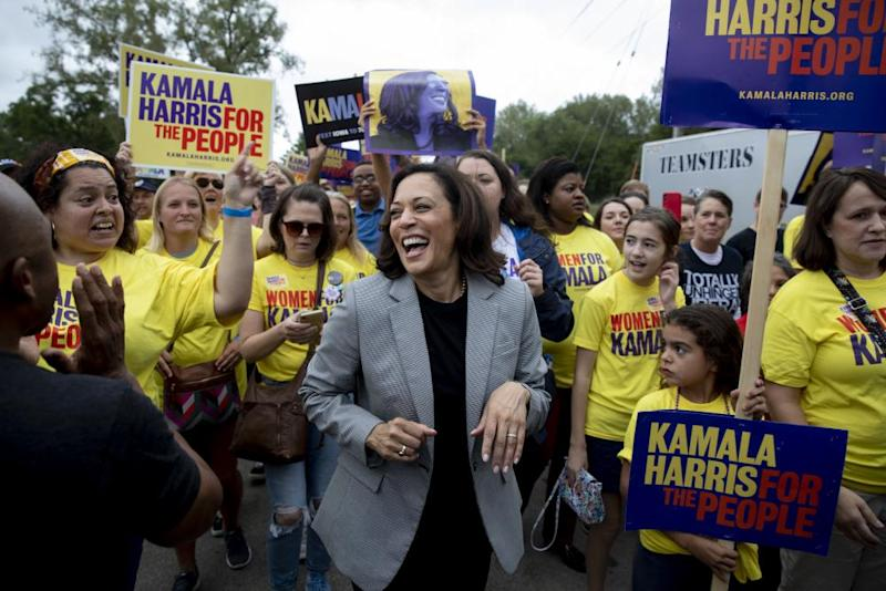 Kamala Harris marches with supporters in Des Moines, Iowa, on 21 September.
