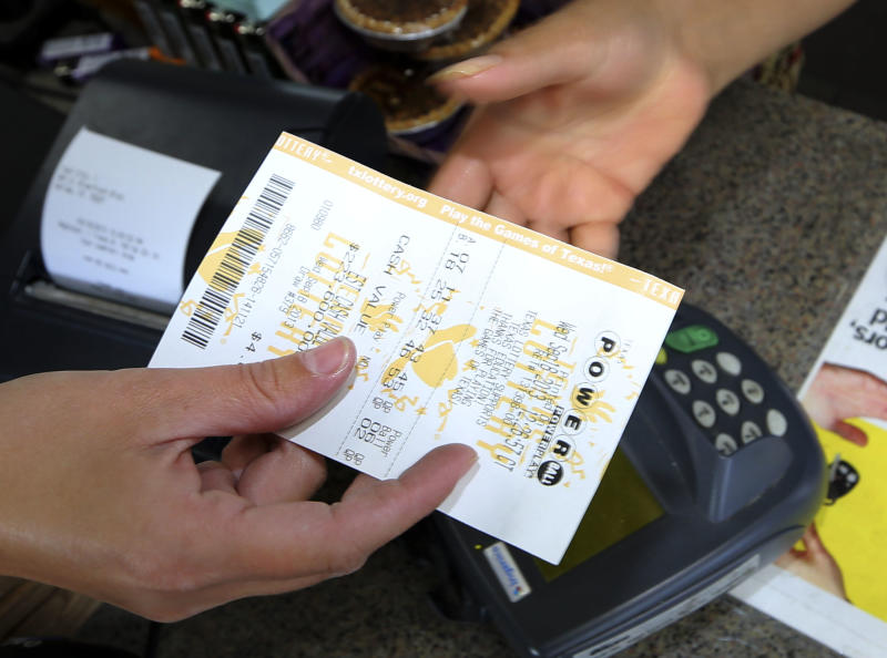 A Powerball lottery ticket is purchased at the Fuel City store in Dallas on Wednesday, Sept. 18, 2013. For Wednesday's drawing, Powerball's estimated $400 million jackpot will be the nation's fifth-largest ever. (AP Photo/LM Otero)