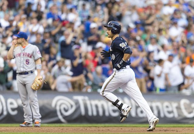 Milwaukee Brewers' Jonathan Lucroy rounds the bases after hitting a solo home run off of New York Mets' Dillon Gee during the first inning of a baseball game Thursday, July 24, 2014, in Milwaukee. (AP Photo/Tom Lynn)