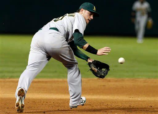 Oakland Athletics third baseman Josh Donaldson chases down a ground out by Texas Rangers' Ian Kinsler in the fifth inning of a baseball game, Tuesday, Sept. 25, 2012, in Arlington, Texas. (AP Photo/Tony Gutierrez)
