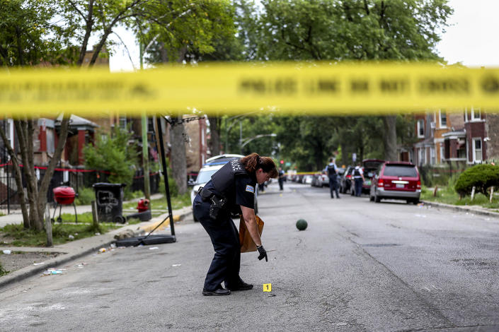 Judge: An officer collects evidence at the scene where an 8-year-old girl was shot on the 1000 block of North Monticello Avenue on Aug. 11, 2019 in Chicago. (Armando L. Sanchez/Chicago Tribune / TNS via Getty Images file)