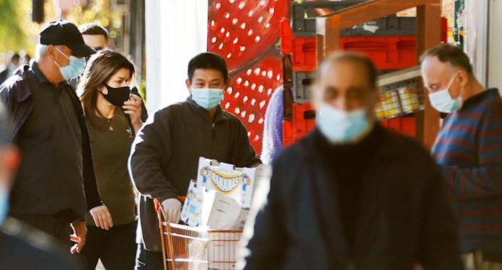 Stock image of Sydney-siders wearing masks in public amid the city's ongoing lockdown. Source: Getty
