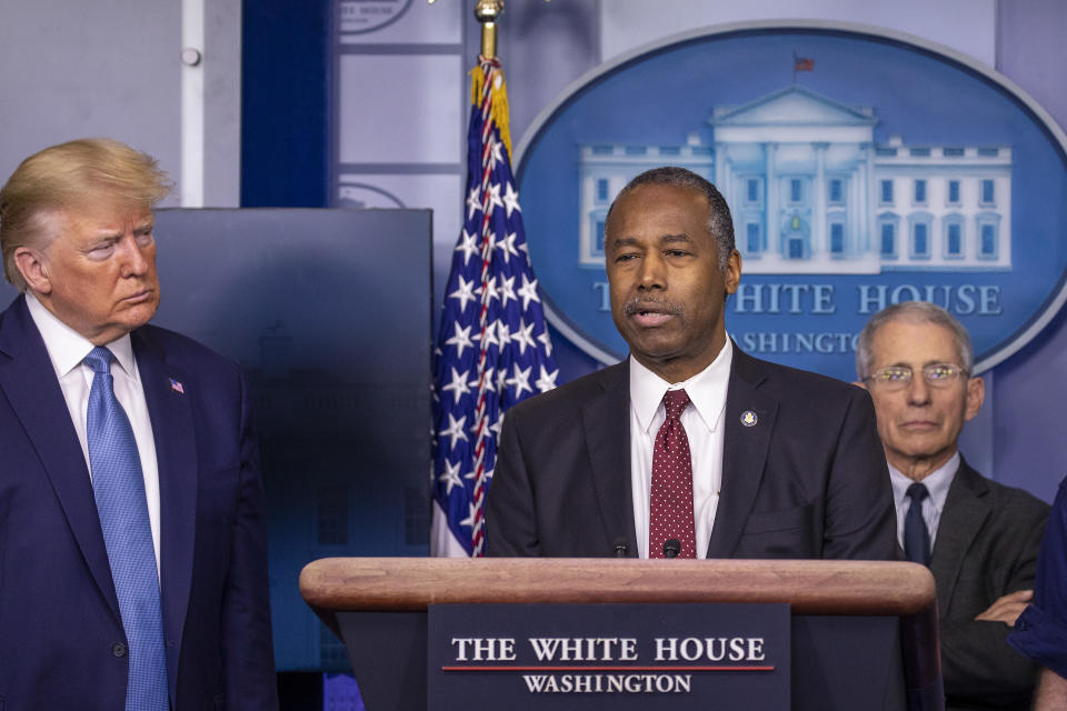 President Trump listens to U.S. Housing and Urban Development Secretary Ben Carson speak during a briefing in the James Brady Press Briefing Room at the White House. (Photo by Tasos Katopodis/Getty Images)
