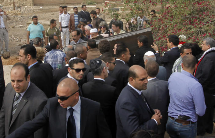 Mourners carry the coffin of Carmen Weinstein, inside the Jewish cemetery in Cairo, Egypt, Thursday, April 18, 2013. Carmen Weinstein, the leader of Egypt's dwindling and aging Jewish community, was well known for her tireless work preserving synagogues and a once-sprawling Jewish cemetery. She died on Saturday, April 13, 2013 at the age of 82. (AP Photo/Amr Nabil)