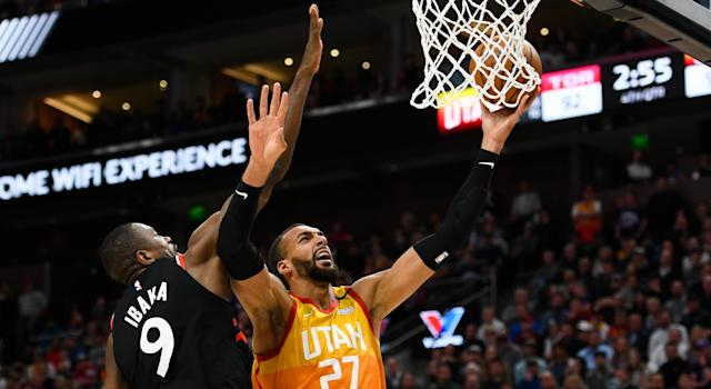 Serge Ibaka of the Toronto Raptors (left) has not contracted the coronavirus after guarding Rudy Gobert of the Utah Jazz in an NBA game on Monday. (Alex Goodlett/Getty Images)