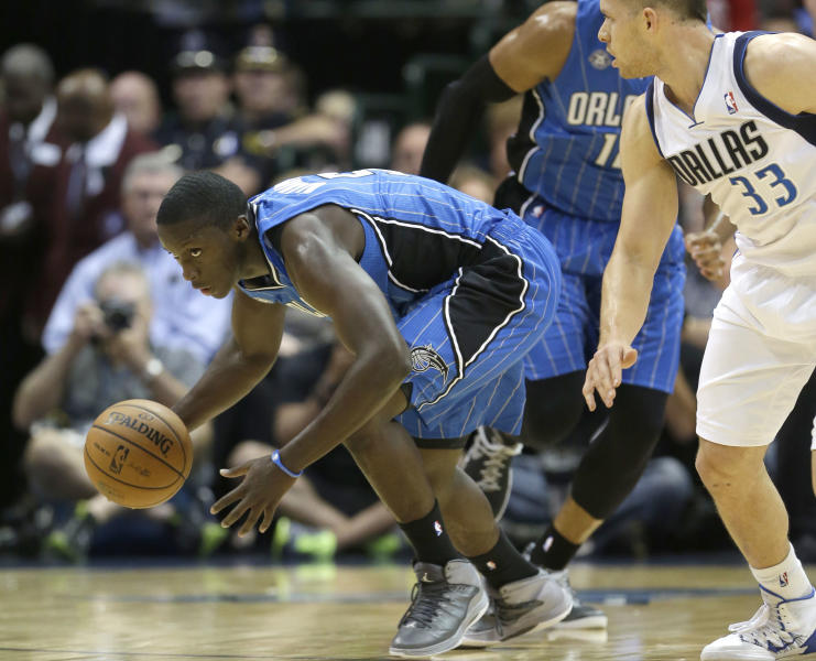 Orlando Magic shooting guard Victor Oladipo (5) steals the ball from Dallas Mavericks point guard Gal Mekel (33) during the first half of an NBA preseason basketball game in Dallas, Monday, Oct. 14, 2013. The Magic won 102-94. (AP Photo/LM Otero)