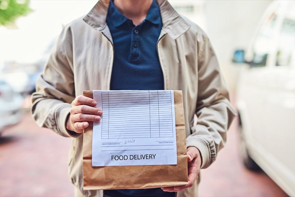 Closeup shot of an unrecognizable man making a food delivery