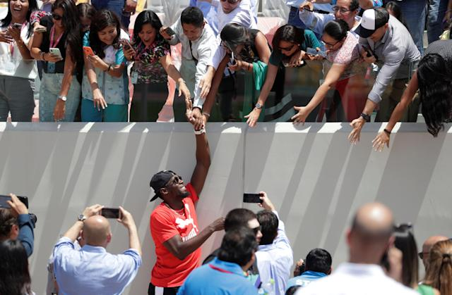 Usain Bolt with fans in the remodeled Atletico de la VIDENA Stadium for the 2019 Pan American Games in Lima, Peru April 3, 2019. REUTERS/Henry Romero