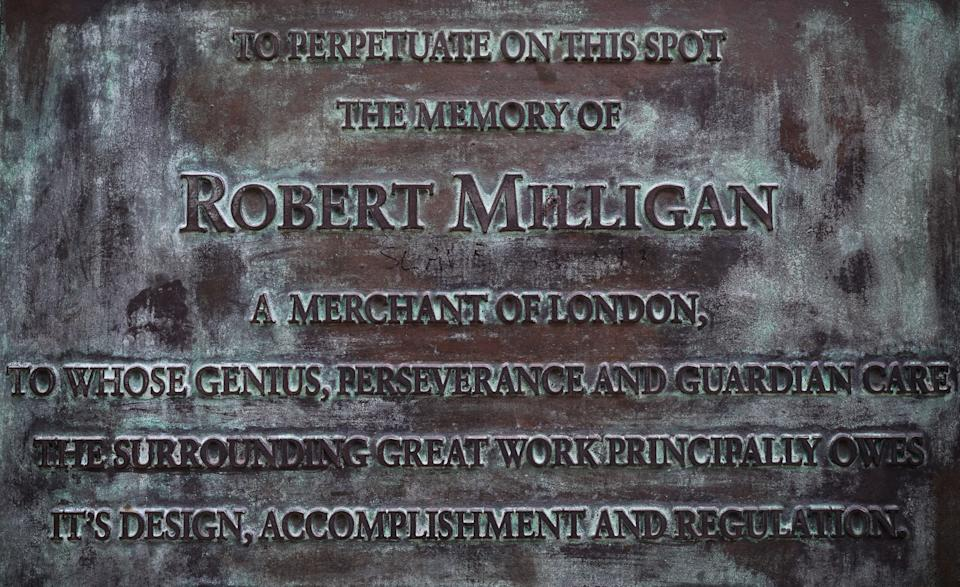 """LONDON, ENGLAND - JUNE 08: Graffiti reading """"Slave Owner"""" is seen on the plaque beneath the statue of Robert Milligan outside the Museum of London Docklands on June 08, 2020 in London, England. Robert Milligan was a noted West Indian merchant, slaveholder and founder of London's global trade hub, West India Docks. Outside the Houses of Parliament, the statue of former Prime Minister Winston Churchill was spray-painted with the words """"was a racist"""" amid anti-racism protests over the weekend. In Bristol, protesters toppled a statue of Edward Colston, a 17th-century slave-trader, and tossed it into the harbour. (Photo by Leon Neal/Getty Images)"""