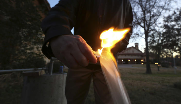 "In this Nov. 27, 2012 photo, water flowing from Steve Lipsky's well ignites when he puts a flame to the well spigot outside his family's home in rural Parker County near Weatherford, Texas. The U.S. Environmental Protection Agency had evidence a gas company's drilling operation contaminated Lipsky's drinking water with explosive methane, and possibly cancer-causing chemicals, but withdrew its enforcement action, leaving the family with no useable water supply, according to a report obtained by The Associated Press. The EPA's decision to roll back its initial claim that hydraulic fracturing, or ""fracking,"" operations had contaminated the water is the latest case in which the federal agency initially linked drilling to water contamination and then softened its position, drawing criticism from Republicans and industry officials who insisted they proved the agency was inefficient and too quick to draw conclusions. (AP Photo/LM Otero)"