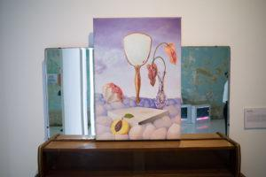 """""""Other Faces"""" by Hee Suhui atop a vanity table. Photo: Carolyn Teo/Coconuts"""