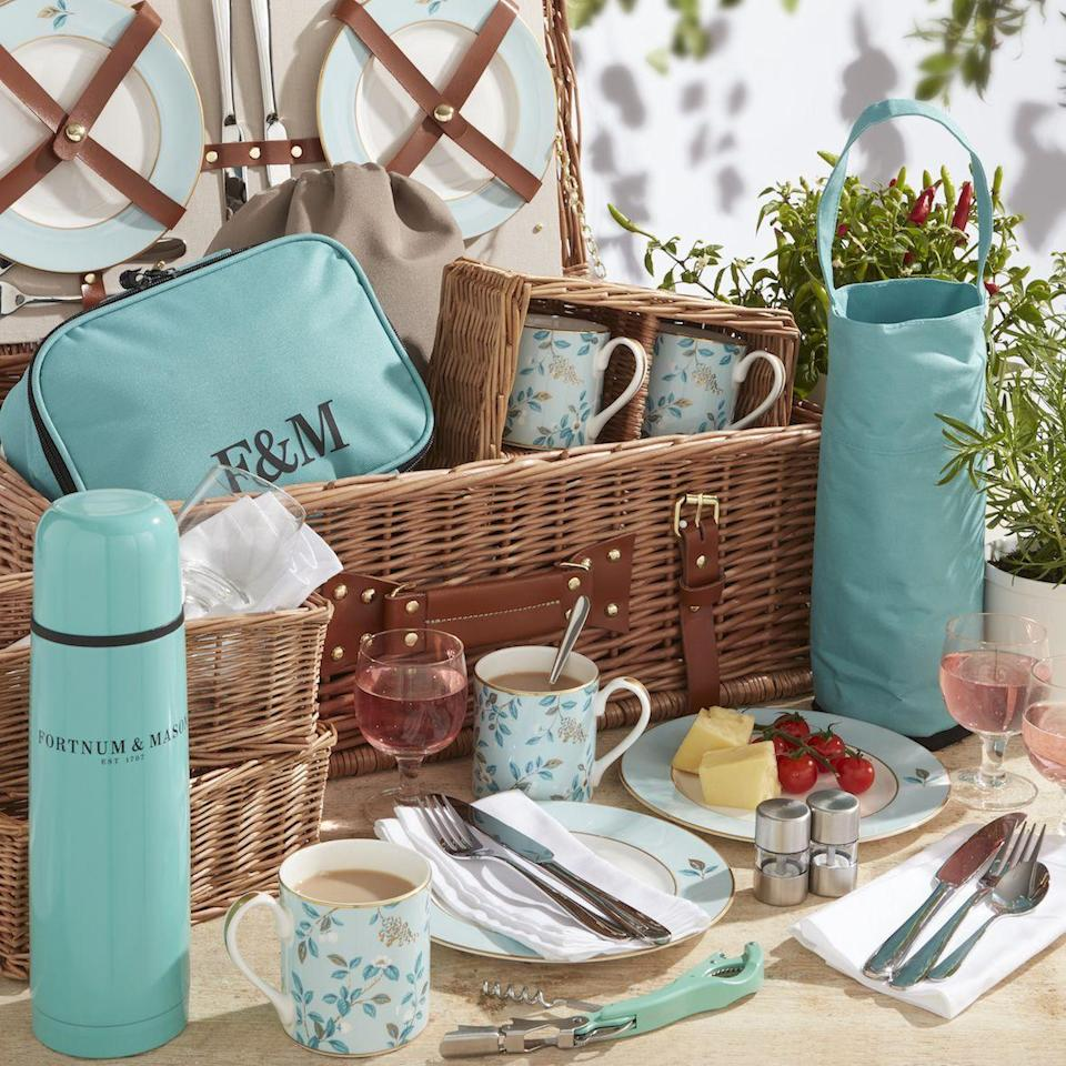 """<p>Whether off on a countryside adventure or enjoying an afternoon in the garden, Fortnum & Mason has the perfect outdoor family spread. Featuring bone-china mugs and plates, four wine glasses, four cutlery sets, a drawstring bag, a freezable wine holder, as well as an insulated flask, the Camellia basket also includes miniature salt and pepper mills, an essential corkscrew and cotton napkins. FC</p><p>Four-person family picnic set, £595, <a href=""""https://www.fortnumandmason.com/the-camellia-4-person-picnic-hamper-2182751"""" rel=""""nofollow noopener"""" target=""""_blank"""" data-ylk=""""slk:Fortnum & Mason"""" class=""""link rapid-noclick-resp"""">Fortnum & Mason</a>.</p>"""