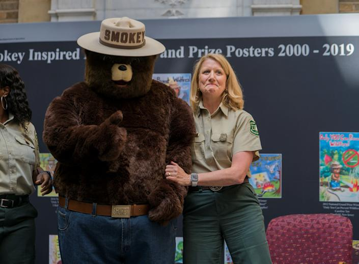 An officer of the Forest Service celebrates Smokey Bear's 75th birthday during a ceremony in Washington, D.C., in August. (Photo: Handout/Reuters)