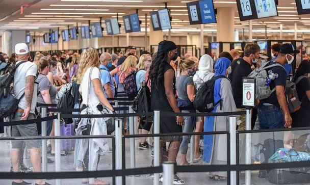 PHOTO: Travelers wait in line for TSA security screening at Orlando International Airport, July 2, 2021, in Orlando, Fla. (SOPA Images/LightRocket via Getty Images)