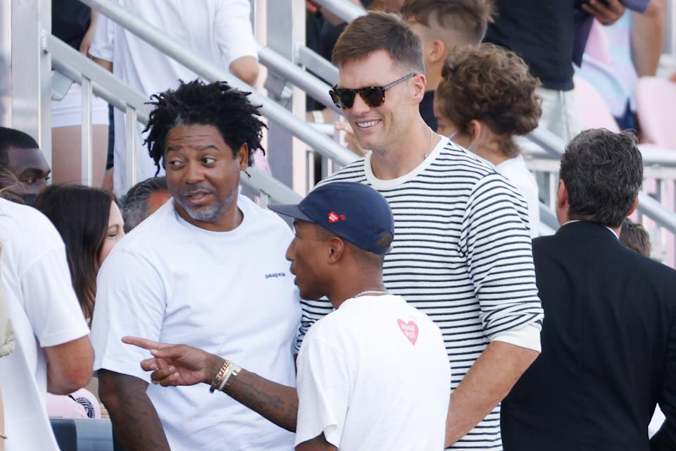 FORT LAUDERDALE, FLORIDA - APRIL 18: NFL player Tom Brady and Pharrell Williams attend the game between Inter Miami FC and the Los Angeles Galaxy at DRV PNK Stadium on April 18, 2021 in Fort Lauderdale, Florida. (Photo by Cliff Hawkins/Getty Images)