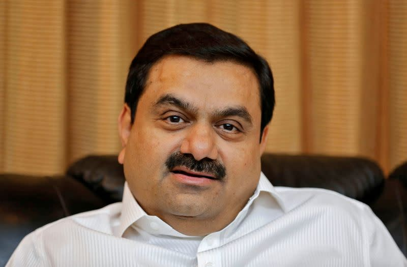 FILE PHOTO: Indian billionaire Adani speaks during an interview with Reuters at his office in Ahmedabad