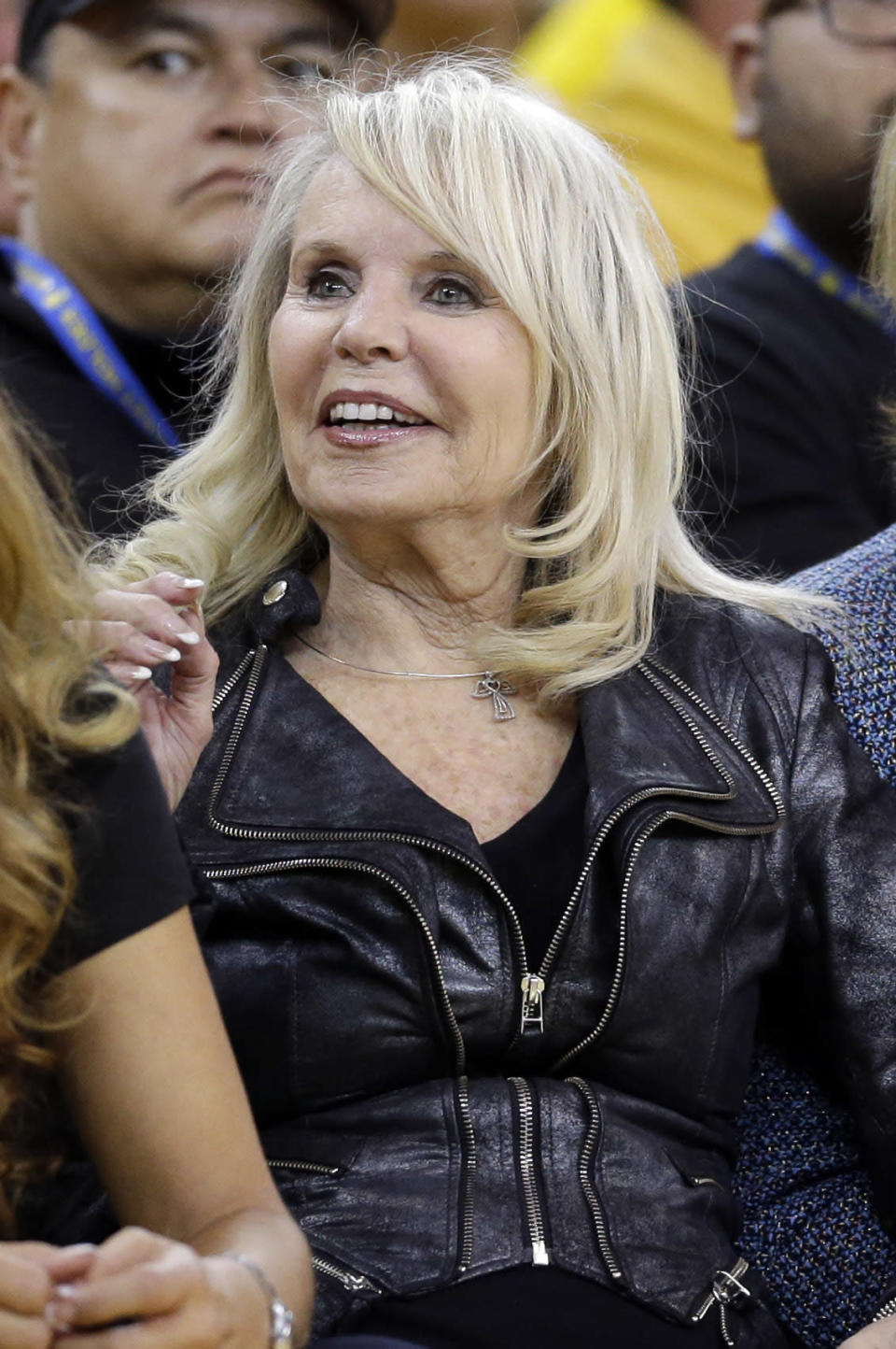 Shelley Sterling, wife of Los Angeles Clippers owner Donald Sterling, watches from a court side seat during the second half in Game 4 of an opening-round NBA basketball playoff series between the Clippers and Golden State Warriors on Sunday, April 27, 2014, in Oakland, Calif. Golden State won 118-97. (AP Photo/Marcio Jose Sanchez)