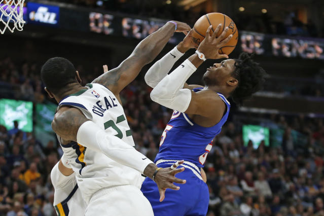 Utah Jazz forward Royce O'Neale (23) defends as Sacramento Kings guard De'Aaron Fox, right, shoots during the first half of an NBA basketball game Saturday, Jan. 18, 2020, in Salt Lake City. (AP Photo/Rick Bowmer)