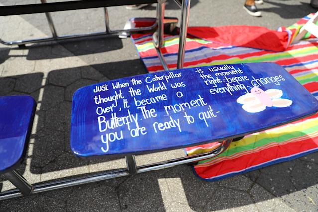 """<p>A carefully written message on one of the seats on the table for """"Suicide prevention"""" on display in Union Square Park in New York City on June 5, 2018. (Photo: Gordon Donovan/Yahoo News) </p>"""