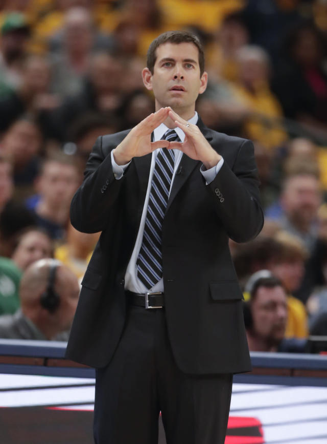 Boston Celtics head coach Brad Stevens calls a play for his teams as the player against the Indiana Pacers during the first half of Game 4 of an NBA basketball first-round playoff series in Indianapolis, Sunday, April 21, 2019. (AP Photo/Michael Conroy)