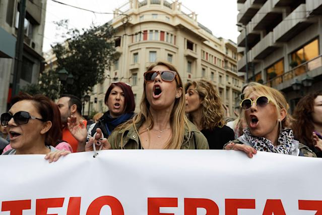 <p>Protesters chant slogans during a nationwide general strike in central Athens Wednesday, May 17, 2017. Greek workers walked off the job across the country Wednesday for an anti-austerity general strike that was disrupting public and private sector services across the country. (AP Photo/Thanassis Stavrakis) </p>