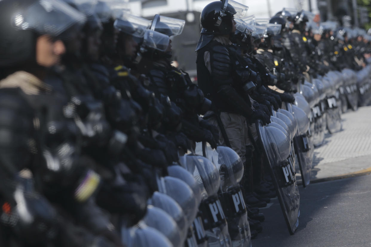 Riot police block an avenue as protesters march against the G20 summit being held in Buenos Aires, Argentina, Friday, Nov. 30, 2018. Leaders from the Group of 20 industrialized nations are meeting in Buenos Aires for two days starting today. (Photo: Sebastian Pani/AP)