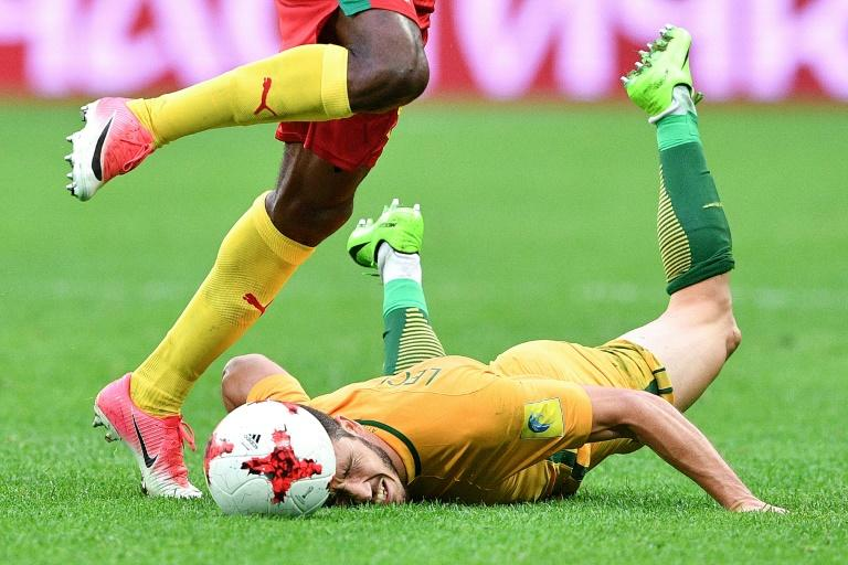 Australia's forward Mathew Leckie falls on the pitch during the 2017 Confederations Cup group B football match between Cameroon and Australia at the Saint Petersburg Stadium in Russia (AFP Photo/Mladen ANTONOV)