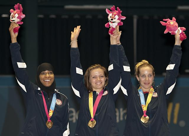 (L to R) Ibtihaj Muhammad, Dagmara Wozniak and Mariel Zagunis of the USA celebrate their gold medal in team sabre during the Guadalajara 2011 Pan American Games, in Guadalajara, Mexico, on October 28, 2011.AFP PHOTO/OMAR TORRES (Photo credit should read OMAR TORRES/AFP/Getty Images)