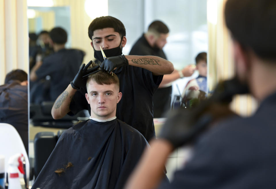 Reading, PA - June 15: Student Joel Sotelo gives a haircut to Cameron Gieringer. At the American Barber and Beauty Academy on Lancaster Ave in Reading Tuesday morning June 15, 2021. (Photo by Ben Hasty/MediaNews Group/Reading Eagle via Getty Images)