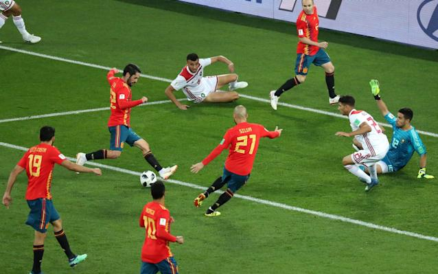 Get live updates from Iran vs Portugal in our other liveblog 8:03PM KICK OFF 2 We're back! Will Morocco still be quite so wired? Kick-off is delayed to make sure that both matches start at the same time... but now we're off. 7:56PM What the scores mean right now As it stands, #POR will play #RUS in the next round while #ESP will face unbeaten #URUhttps://t.co/Q5EI0I5l95pic.twitter.com/O5a8sxy3GZ— Telegraph Football (@TeleFootball) June 25, 2018 7:52PM Team shape Average touch positions (44 min) 7:52PM BBC's budget pundits Leon Osman and Joleon Lescott have been summoned for the half-time punditry in the BBC's studio, which looks an awful lot like the same studio used in BBC Newsround during the 90s. Spain got caught out then by a determined, angry looking Morocco team but had the sheer class and patience to get back into it. I can see more goals coming in the second half! 7:47PM HALF TIME That was terrific. 7:45PM 45 mins - Spain 1 Morocco 1 Morocco now pressing high up the pitch to stop Spain passing out from the back so easily. They win a throw-in and the fans go absolutely wild. Alba gets up the pitch but gives away a goal kick. 7:43PM 43 mins - Spain 1 Morocco 1 Spain vs Morocco This graphic tells a story. Spain with heaps of passes but always going forward. Morocco going direct, quickly. 7:42PM 42 mins - Spain 1 Morocco 1 The free-kick is curled into the area, Busquets meets it at the back post but can't connect and Morocco clear. Spain build from the back again. 7:40PM 40 mins - Spain 1 Morocco 1 Isco runs himself into trouble and it's a late tackle by Boutaib... who hasn't been booked... but the referee doesn't show a yellow card. Isco takes a ball to feet, turns his man and then nutmegs the next. Brilliant. Spain win a free-kick 35 yards out and that's a clear shirt pull, which again could be a yellow card. 7:37PM 38 mins - Spain 1 Morocco 1 BUSQUETS!!! He's missed a free header from the penalty spot. He had to score there! Morocco survive. 7:36PM 36 mins - 