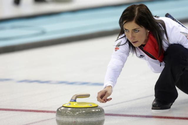 Britain's women's curling team skip Eve Muirhead delivers a stone during a training session in preparation for the 2014 Sochi Winter Olympics, at the Ice Cube Curling Center in Sochi February 9, 2014. REUTERS/Ints Kalnins (RUSSIA - Tags: SPORT OLYMPICS CURLING)