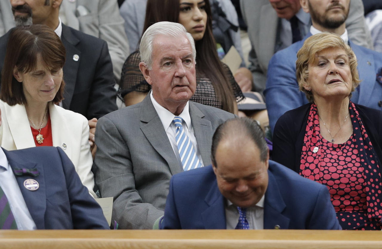 Craig Reedie (C), President of the World Anti-Doping Agency looks on from the Royal box on centre court on the fifth day of the 2016 Wimbledon Championships at The All England Lawn Tennis Club in Wimbledon, southwest London, on July 1, 2016. (AFP Photo/ADRIAN DENNIS)