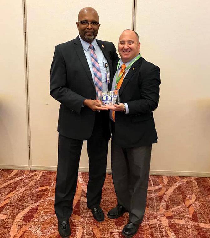 Inkster Department Chief William Riley stands with Lt. Jeff Twardzik after he received the Law Enforcement Officer of the Year for his work with the Mobile Crisis Team Partnership with Hegira Health C.O.P.E. (Community Outreach for Psychiatric Emergencies) Program. (Inkster Police Department / via Facebook)