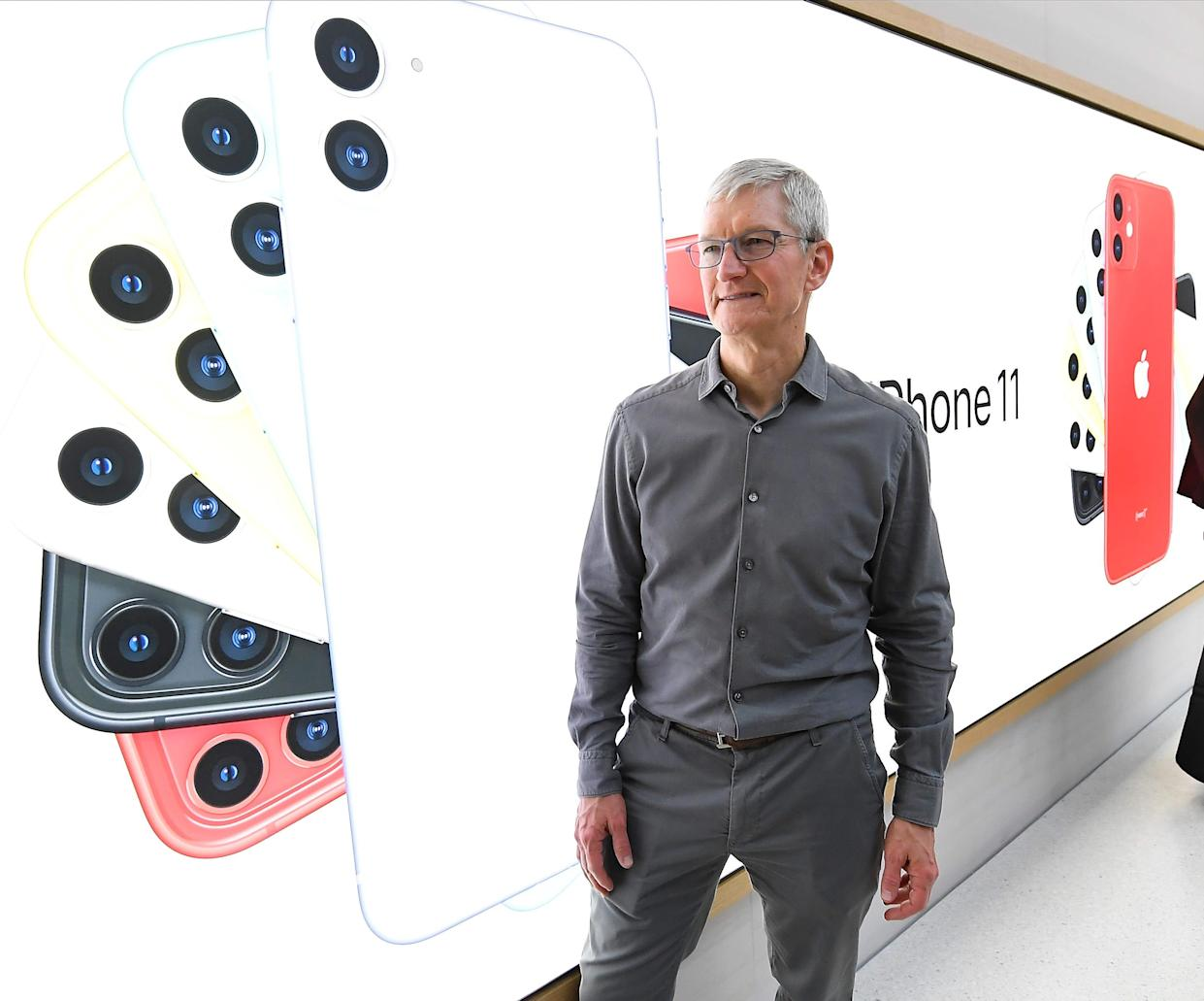 CEO Tim Cook greets shoppers inside the Apple store on New York's Fifth Avenue in September 2019.