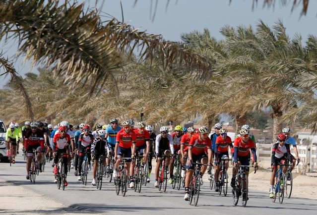 REFILE - CORRECTING COUNTRY SPELLING Hundreds of cyclists ride with the Bahrain-Merida Pro Cycling Team, seen in the front row, during their social cycle ride to promote the sports in the country, in Manama, Bahrain February 2, 2018. REUTERS/Hamad I Mohammed