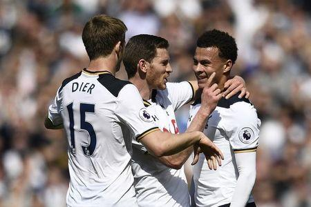 Britain Football Soccer - Tottenham Hotspur v Watford - Premier League - White Hart Lane - 8/4/17 Tottenham's Dele Alli celebrates scoring their first goal with Jan Vertonghen and Eric Dier  Reuters / Dylan Martinez Livepic