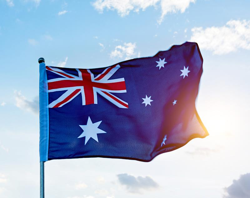 Waving Australia flag in the air. Source Getty ImagesMore