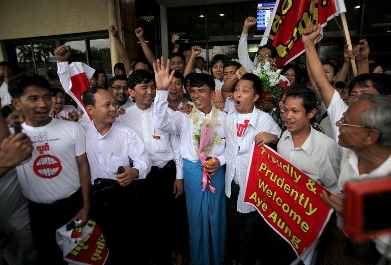 File photo of supporters of Myanmar political prisoners, welcoming amnestied prisoners, in Yangon, on July 4, 2012