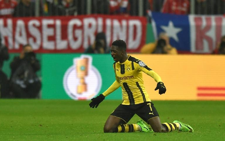 Dortmund's midfielder Ousmane Dembele celebrates after the second goal for Dortmund during the German Cup DFB Pokal semifinal football match between against Bayern Munich April 26, 2017
