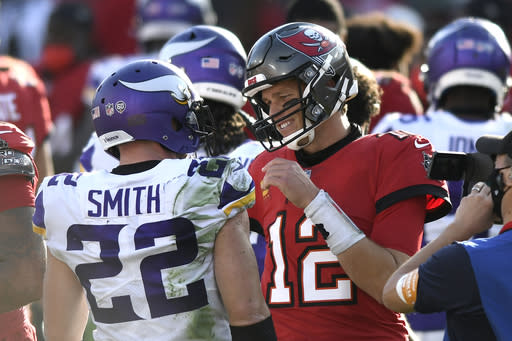 Tampa Bay Buccaneers quarterback Tom Brady (12) talks to Minnesota Vikings strong safety Harrison Smith (22) after an NFL football game Sunday, Dec. 13, 2020, in Tampa, Fla. (AP Photo/Jason Behnken)