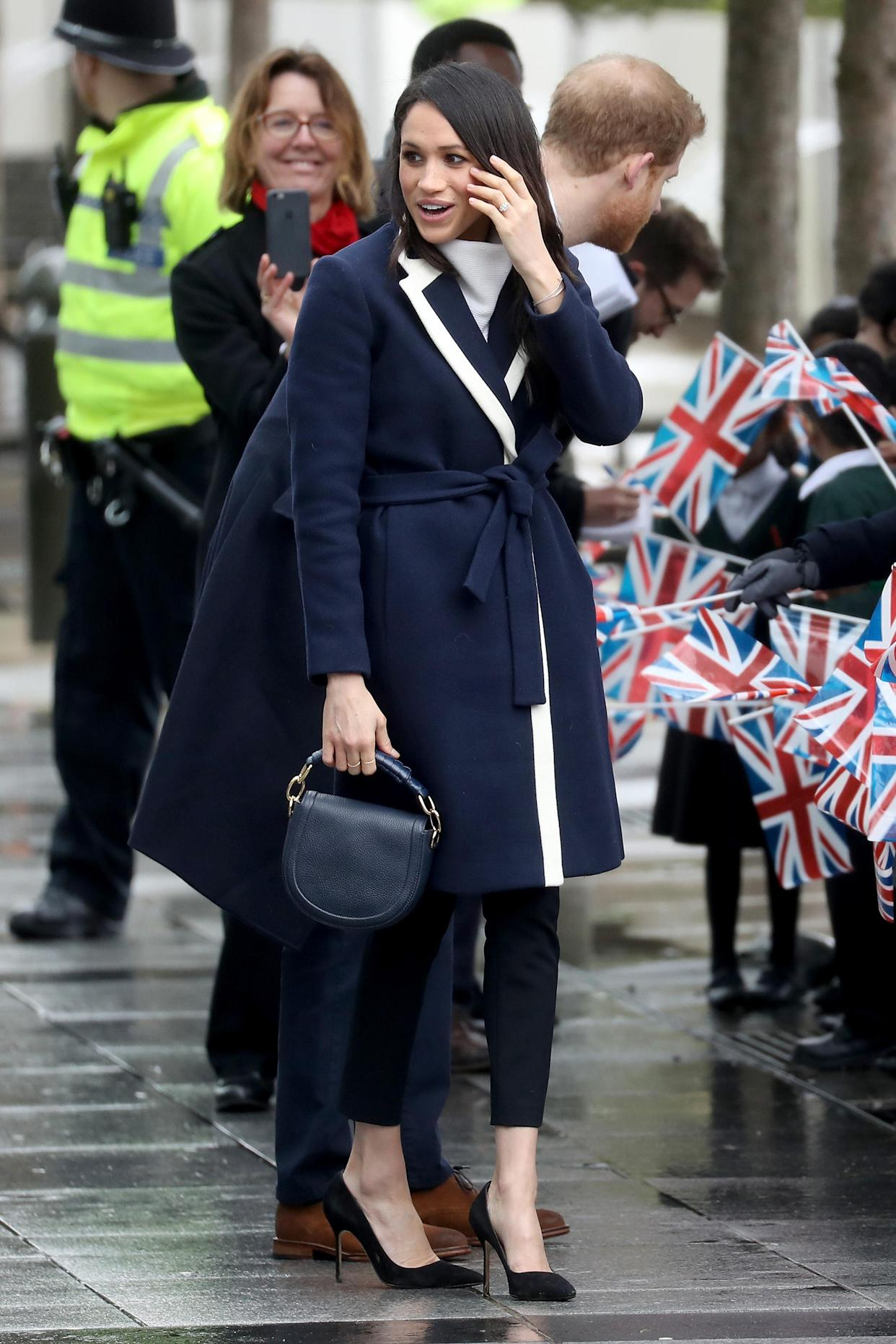 Markle visited Birmingham, England, in a J.Crew coat. (Photo: Chris Jackson/Getty Images)
