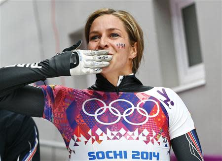 Noelle Pikus-Pace of the U.S. reacts after competing in the women's skeleton event at the 2014 Sochi Winter Olympics, at the Sanki Sliding Center in Rosa Khutor February 14, 2014. REUTERS/Arnd Wiegmann \