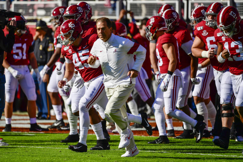 Alabama head coach Nick Saban leads his team onto the field before an NCAA football game against LSU Saturday, Nov. 9, 2019, in Tuscaloosa, Ala. (AP Photo/Vasha Hunt)