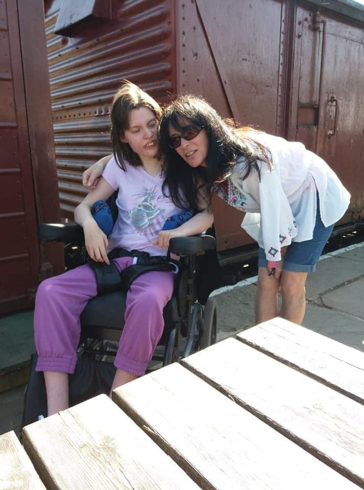 Rose (pictured with her mother) now has a specialist bath in her new accommodation (Julie Allen)