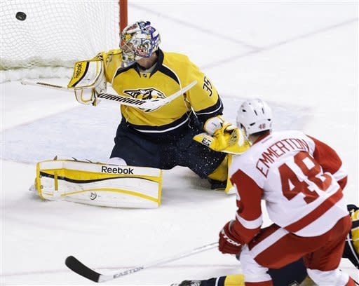 Detroit Red Wings center Cory Emmerton (48) scores against Nashville Predators goalie Pekka Rinne (35), of Finland, in the first period of Game 2 of an NHL hockey Stanley Cup first-round playoff series, Friday, April 13, 2012, in Nashville, Tenn. (AP Photo/Mark Humphrey)
