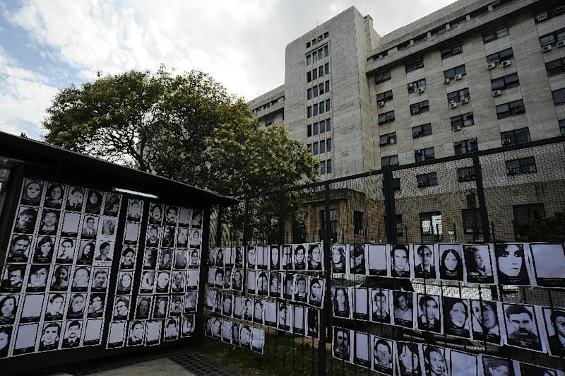 Images of people who disappeared under Argentina's military junta are displayed outside the federal courthouse during sentencing of 48 ex-military personnel convicted of crimes at a notorious torture center (AFP Photo/Javier Gonzalez Toledo)