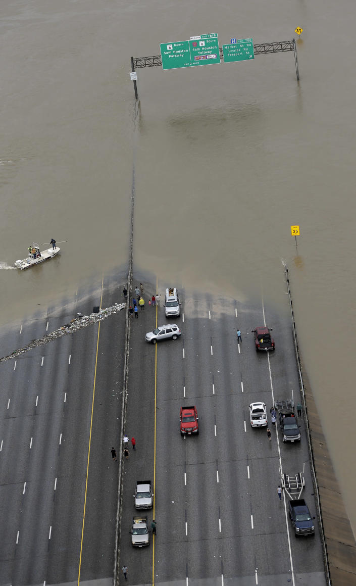 <p>Interstate 10 is closed due to floodwaters from Tropical Storm Harvey Tuesday, Aug. 29, 2017, in Houston. (Photo: David J. Phillip/AP) </p>