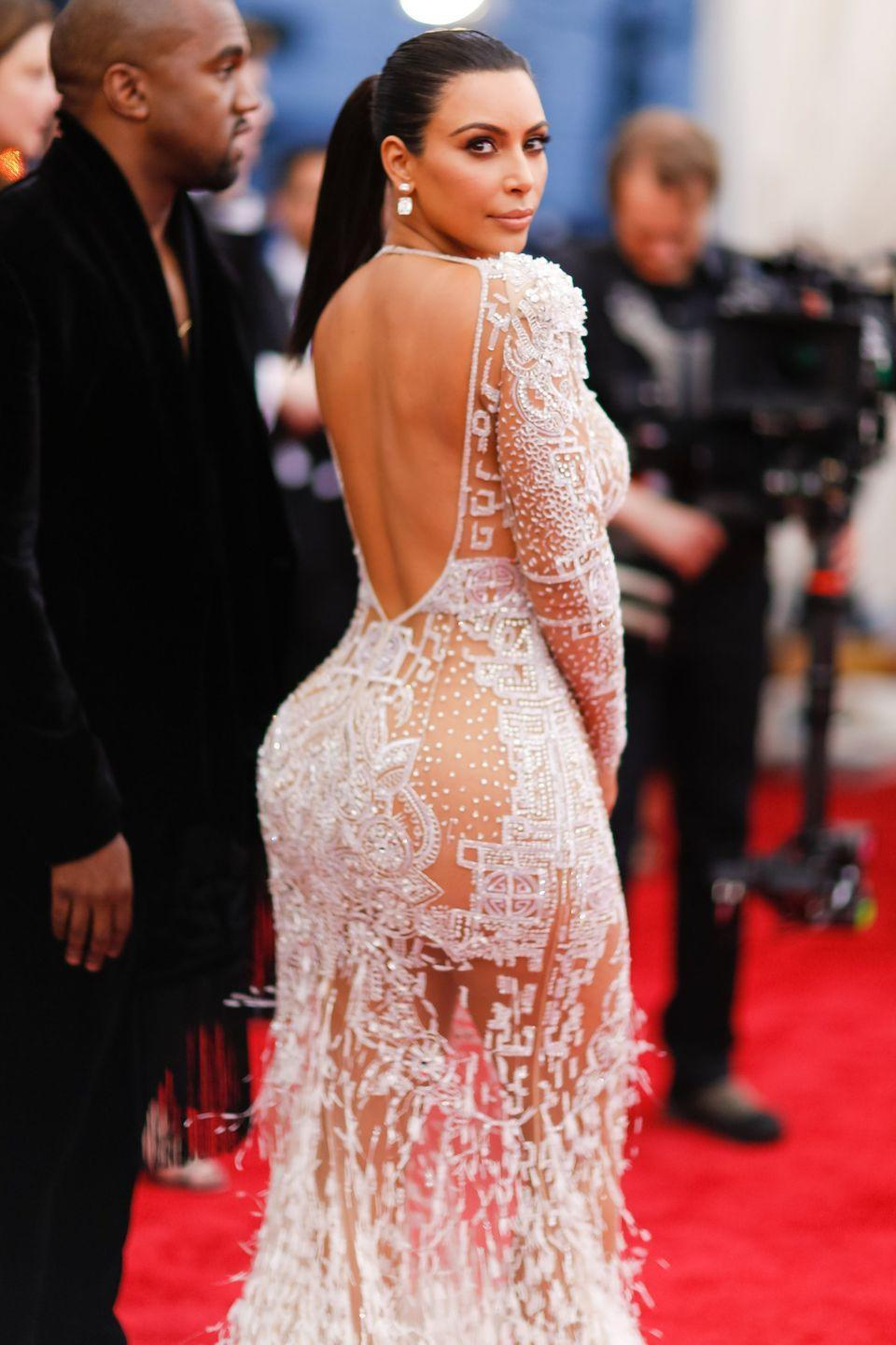 <p>Kim K. wore a similarly sheer Roberto Cavalli dress to the Met Ball the same year.</p>