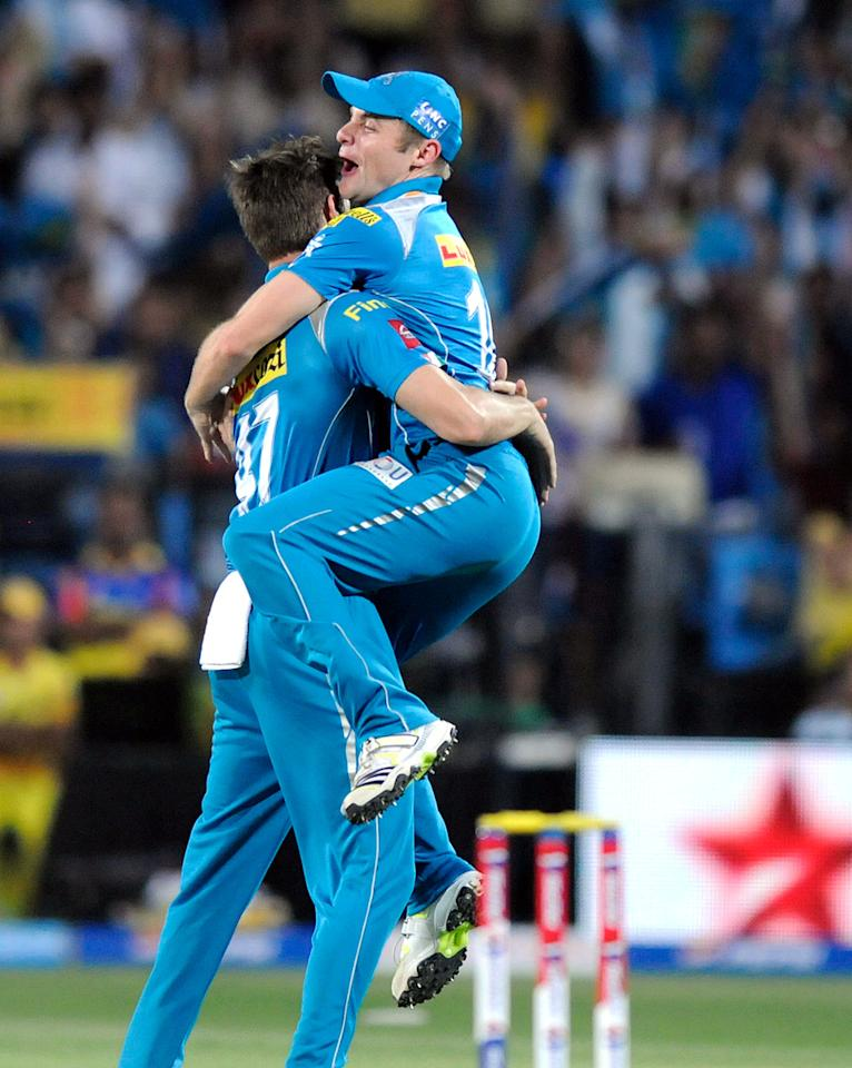 Kane Richardson of Pune Warriors celebrates the wicket of Michael Hussey of Chennai Super Kings with teammate Kuke Wright of Pune Warriors during match 42 of the Pepsi Indian Premier League ( IPL) 2013  between The Pune Warriors India and the Chennai Superkings held at the Subrata Roy Sahara Stadium, Pune on the 30th April  2013.(BCCI)